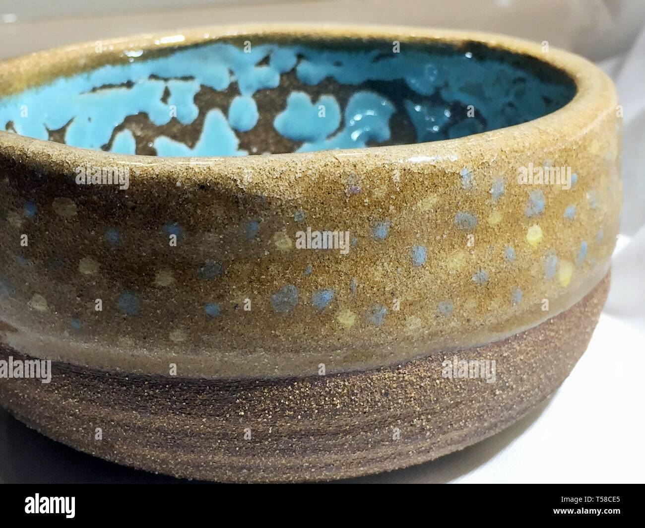 Handmade pottery from a local artist, fired to cone 10 and glazed with food-safe glazes - Stock Image