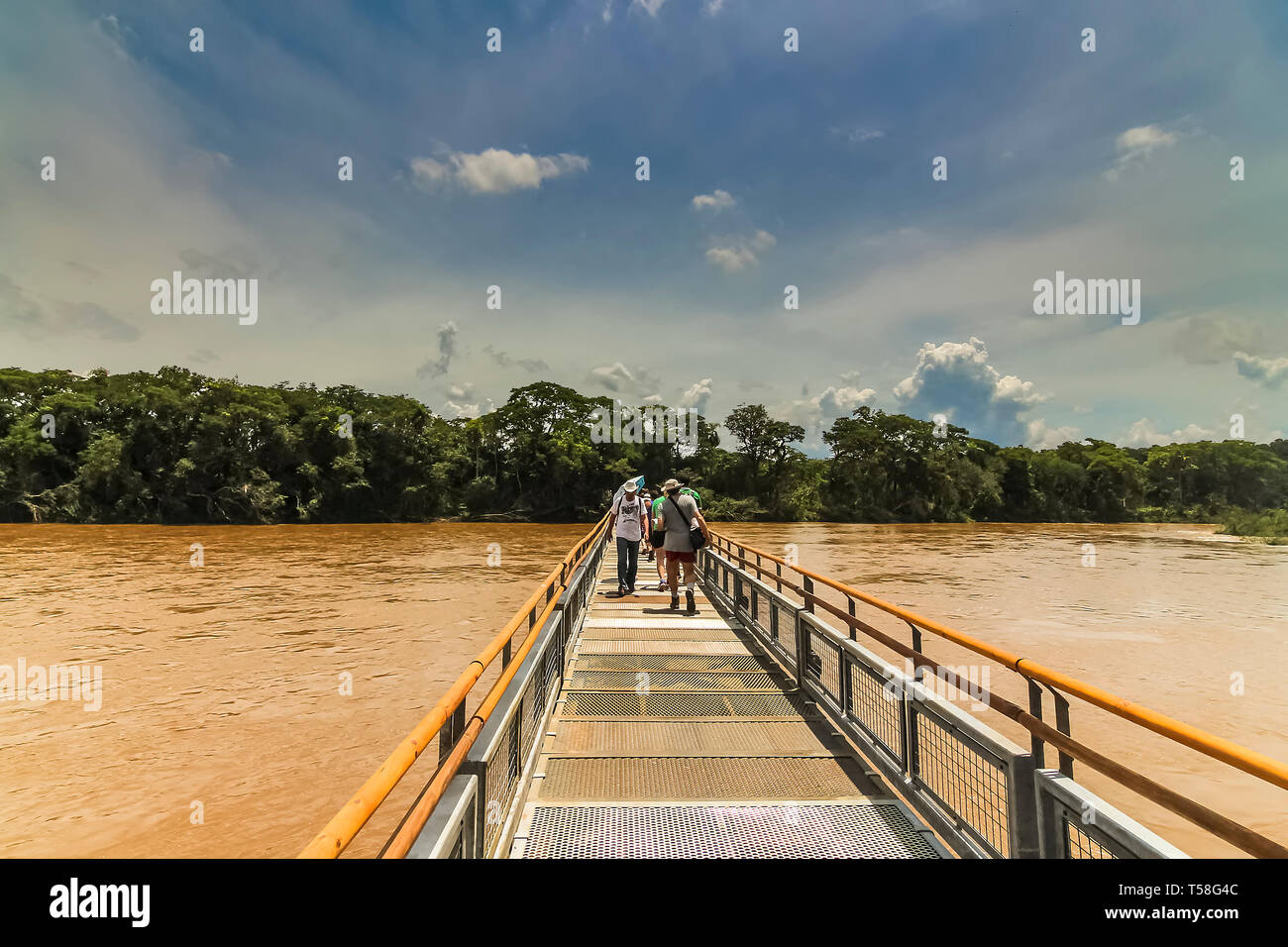 Misiones Province, Argentina - Jan 2015: The metal walkway from Pueto Iguazu towards the waterfalls at Iquazu Falls - Stock Image