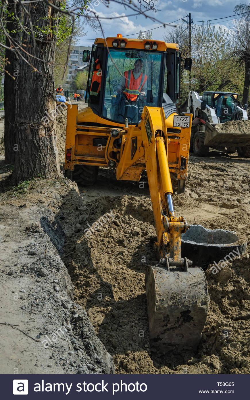 Tyumen, Russia - May 5, 2007: Excavators machine on road construction site - Stock Image