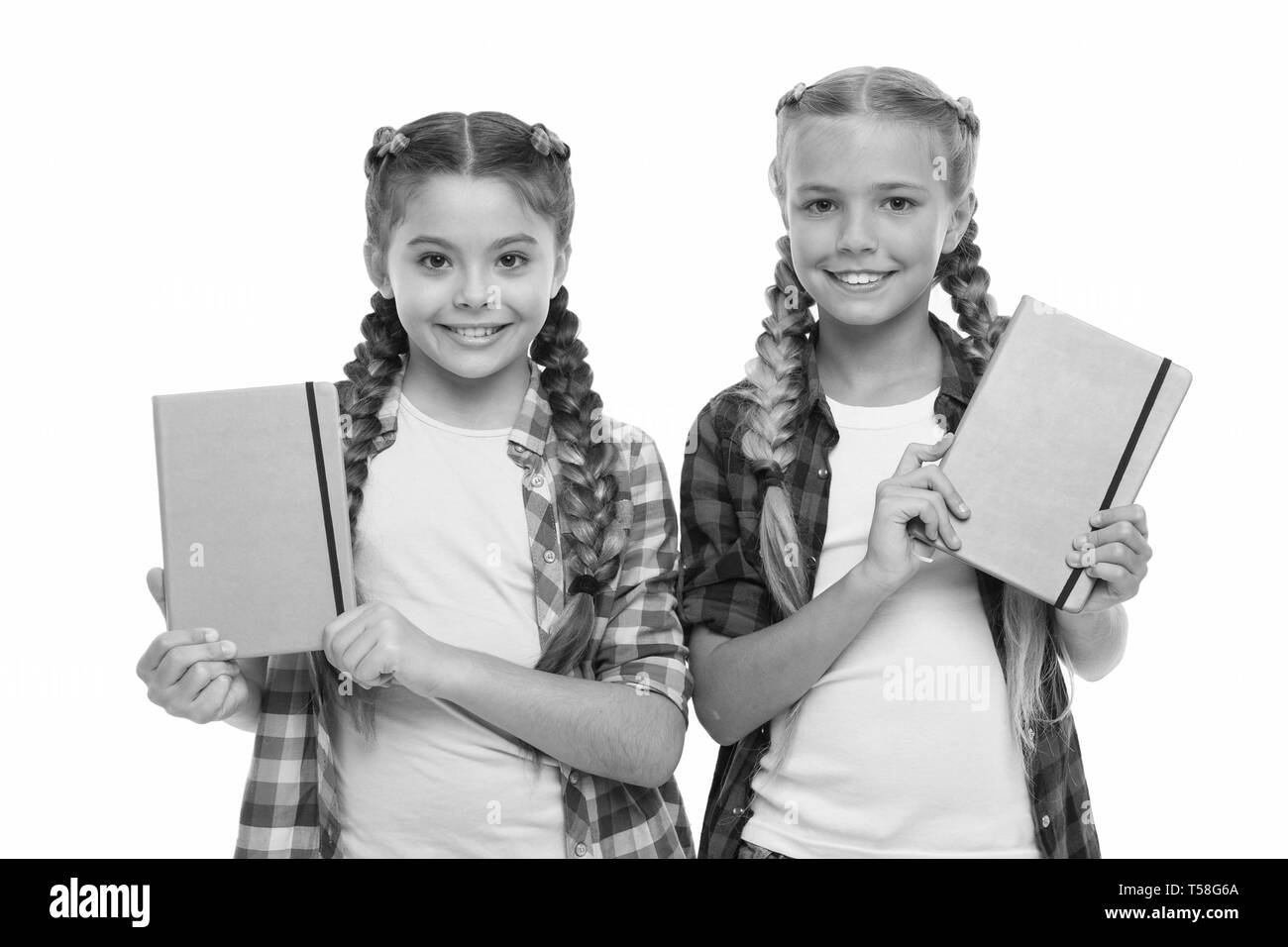 Diary for girls concept. Children cute girls hold notepads or diaries isolated on white background. Note secrets down in your cute girly diary journal - Stock Image