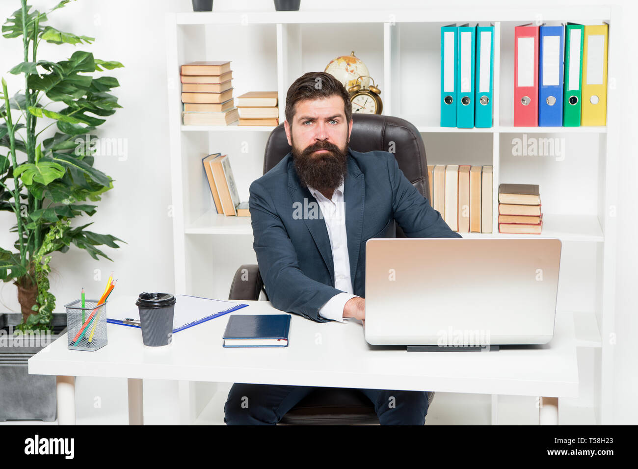 Office staff concept. Office routine. Businessman in charge of business solutions. Developing business strategy. Risky business. Man bearded boss sit with laptop. Manager solving business problems. - Stock Image