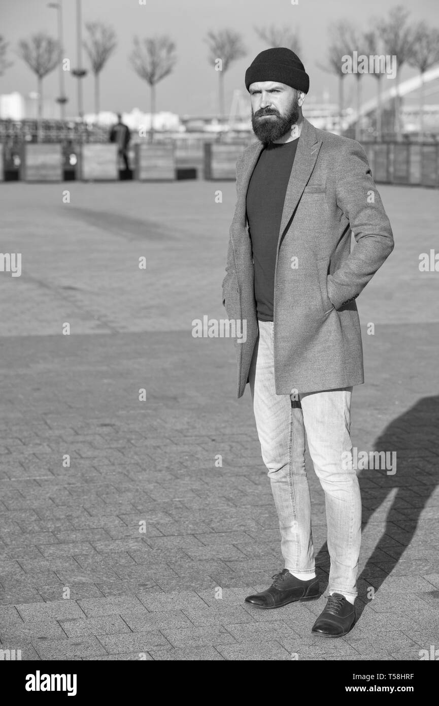Masculine casual outfit. Hipster outfit. Stylish casual outfit for fall and winter season. Menswear and male fashion concept. Man bearded hipster stylish fashionable coat. Comfortable and cool. - Stock Image