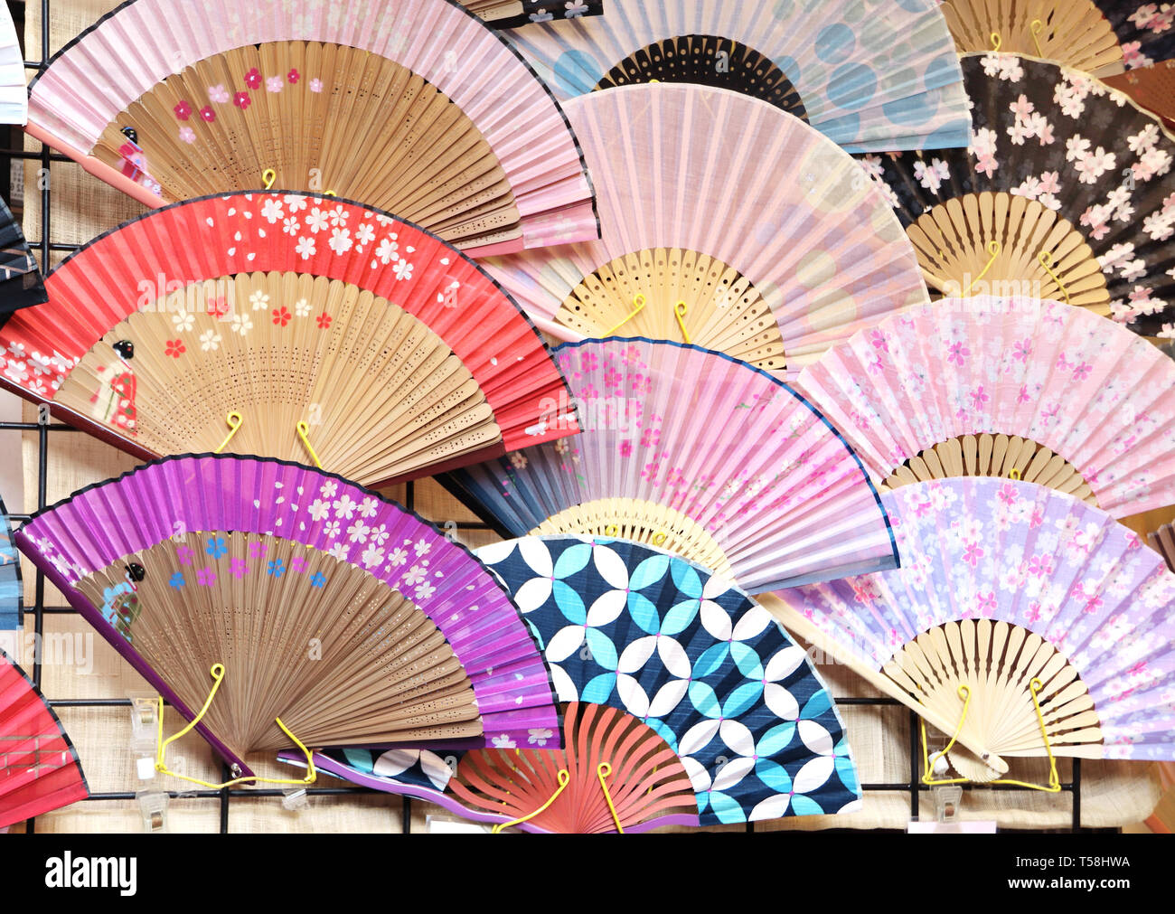 69bf41885071c Souvenirs - traditional Japanese fans with sakura flowers ornaments - Stock  Image