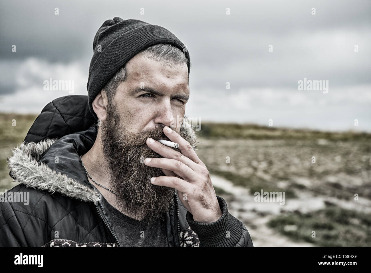 unhealthy lifestyle, bad habit and addiction, hiking and camping, traveling and wanderlust, hairdresser and barbershop, hair fashion, hipster lifestyle, people and nature, outwear fashion - Stock Image