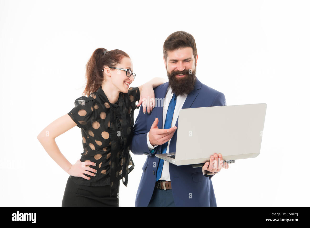 Financial report. Financial indicators. Couple working using laptop. Business lady check what is done. Lady boss satisfied with business indicators. Manager show result. Report business result. - Stock Image