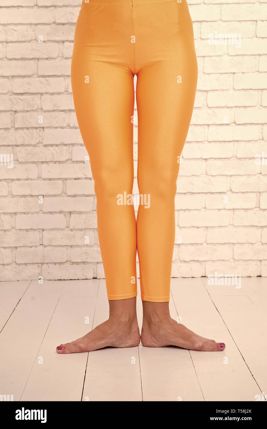 8563d84be first ballet position of female feet in orange tights. leg of dancer in  first position