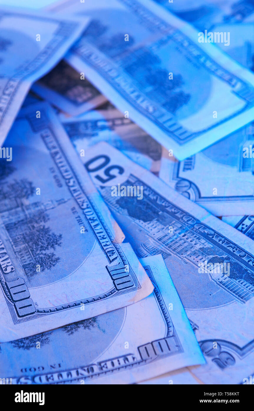 us dollars with colorful light - Stock Image