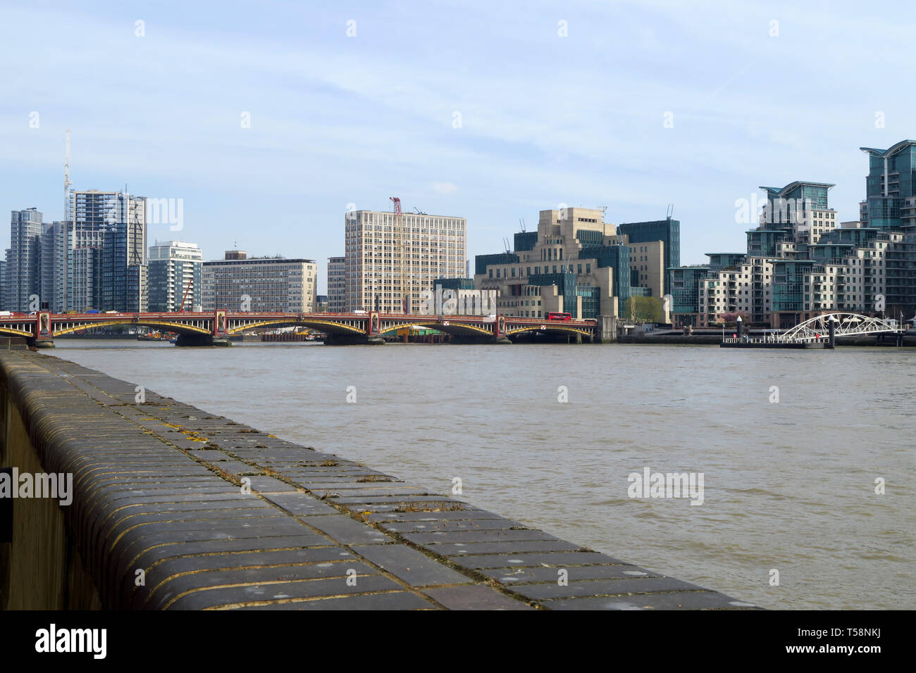 The MI6 Building stands on the south bank of the River Thames by Vauxhall Bridge, London Stock Photo