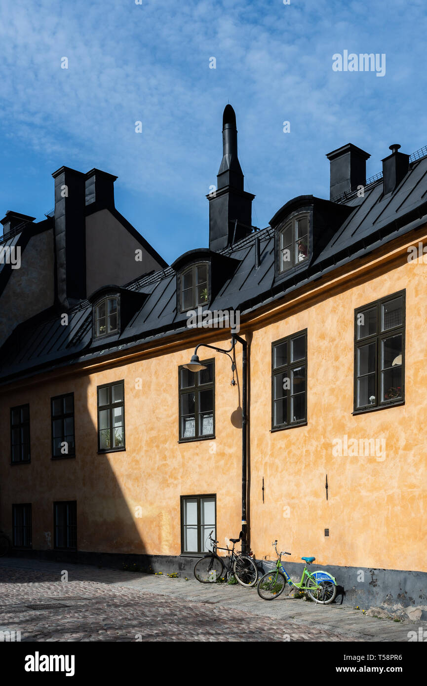 Bikes on a sunny day in Södermalm, Stockholm. - Stock Image