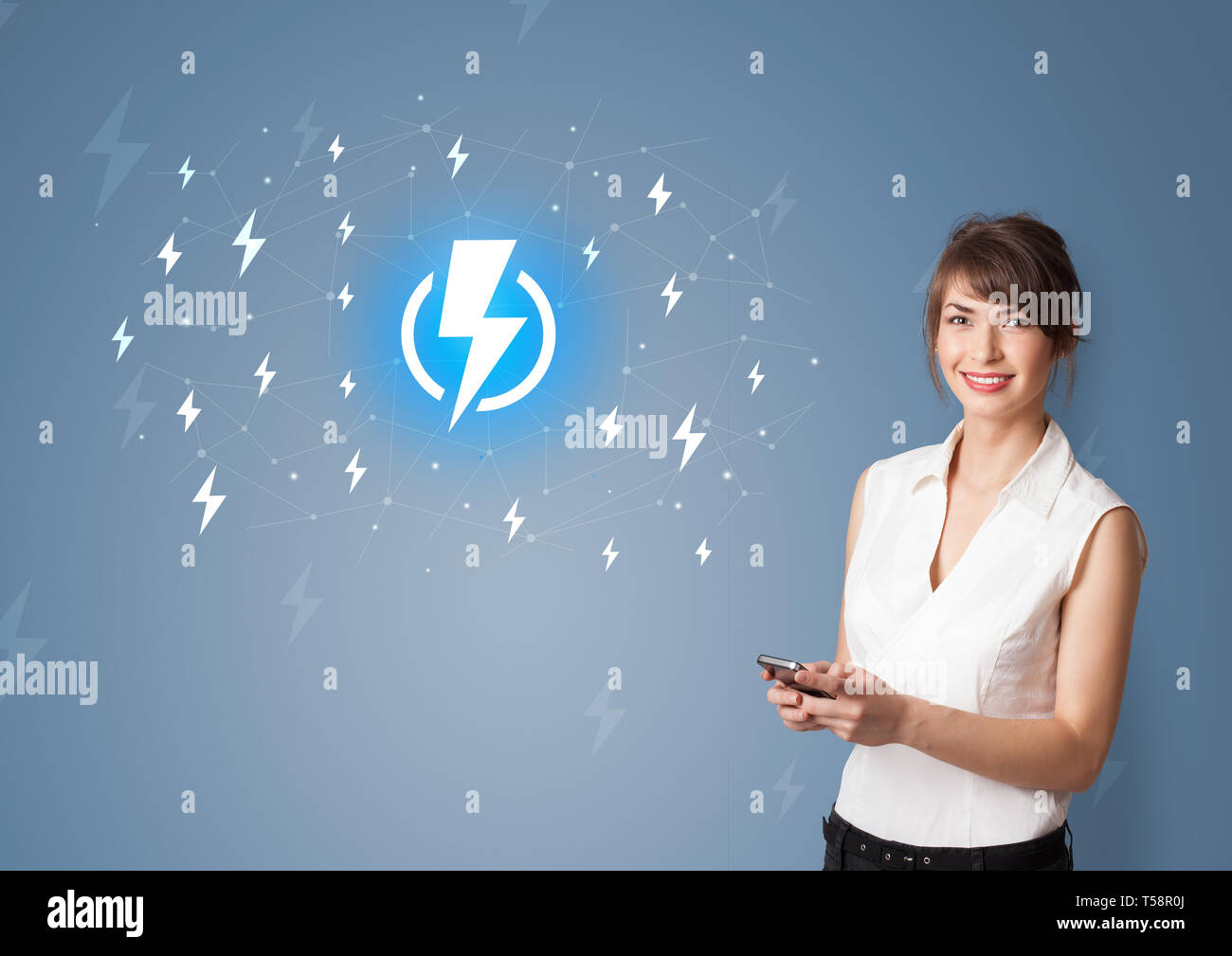 Young smiling person presenting battery life concept  - Stock Image