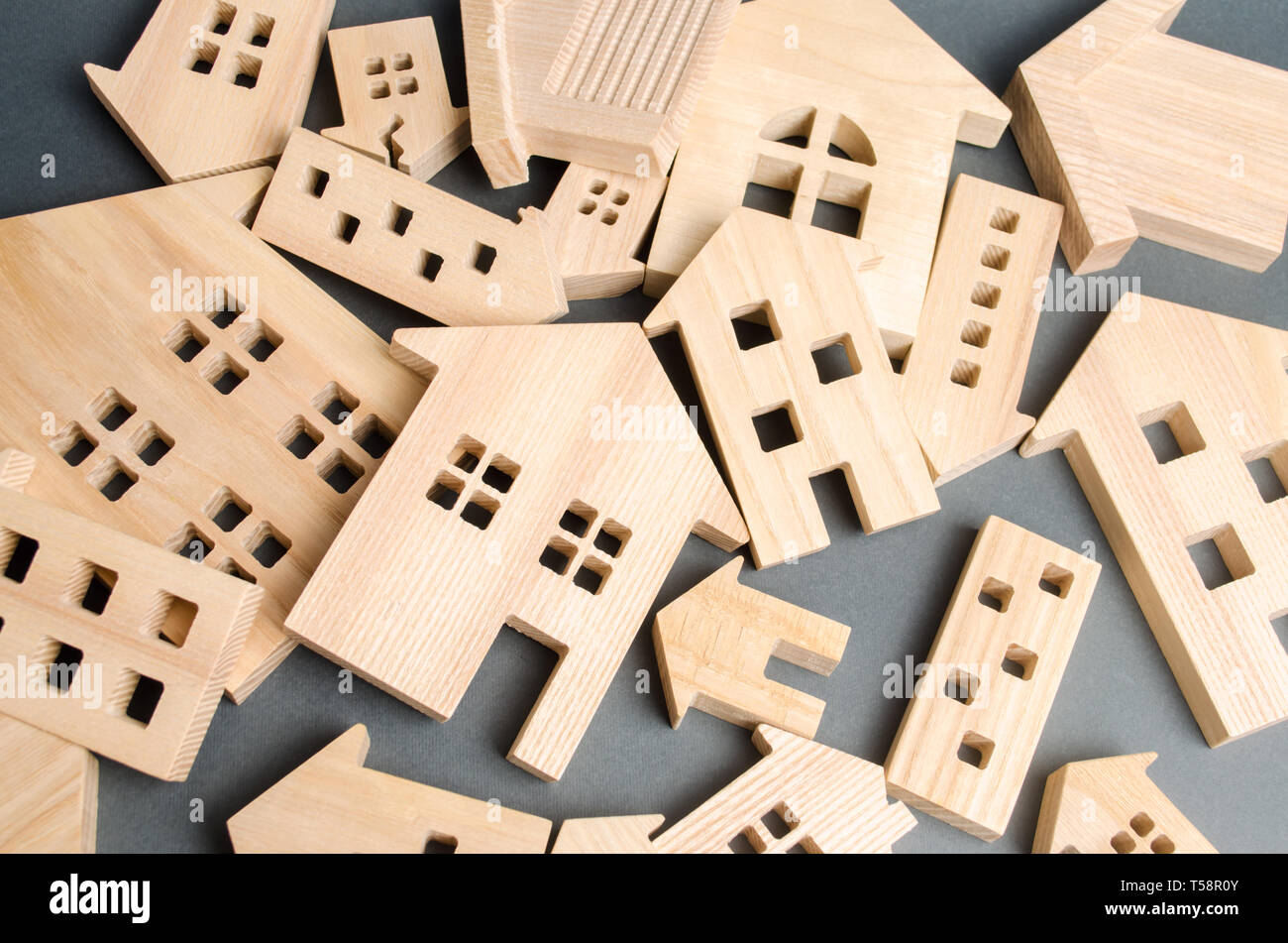 Many felled wooden houses. Destruction of houses as a result of natural disaster. The flood. Hurricane. Fire. Danger. Emergency housing. Reconstructio - Stock Image
