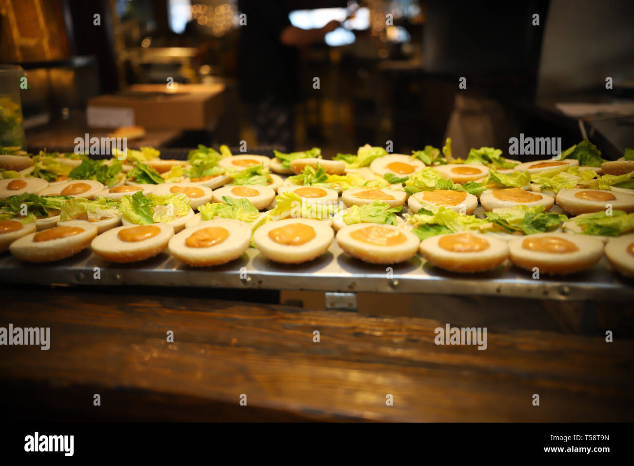 Modern cafe. A stand with buns with sauce on top Stock Photo