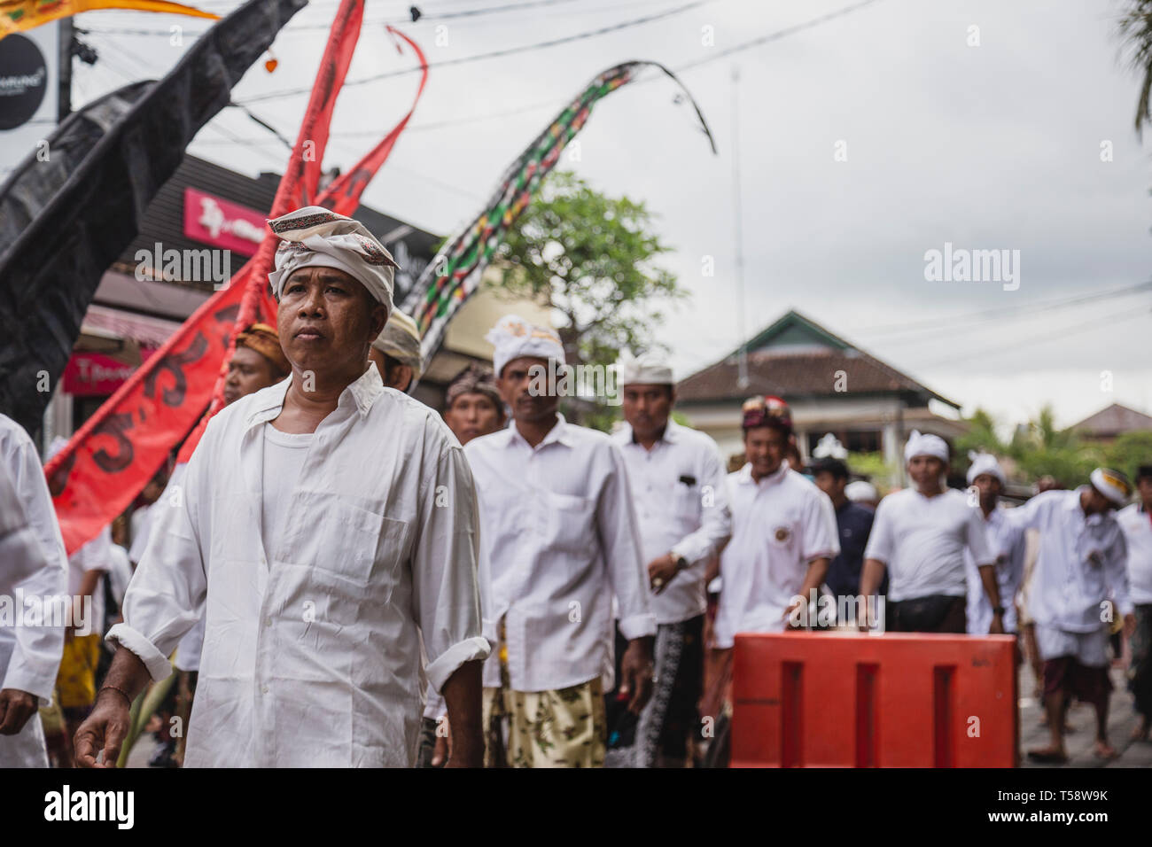 Worshipers Marching to a Temple during a Festival in Bali, Indonesia - Stock Image