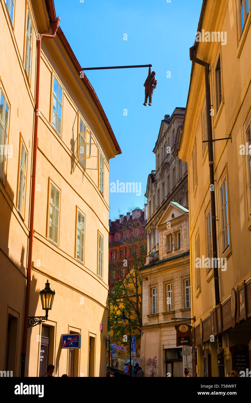 PRAGUE, CZECH REPUBLIC - July, 2018: Sculpture of the psychoanalyst Sigmund Freud hanging by a hand called Man Hanging Out created by the artist David - Stock Image