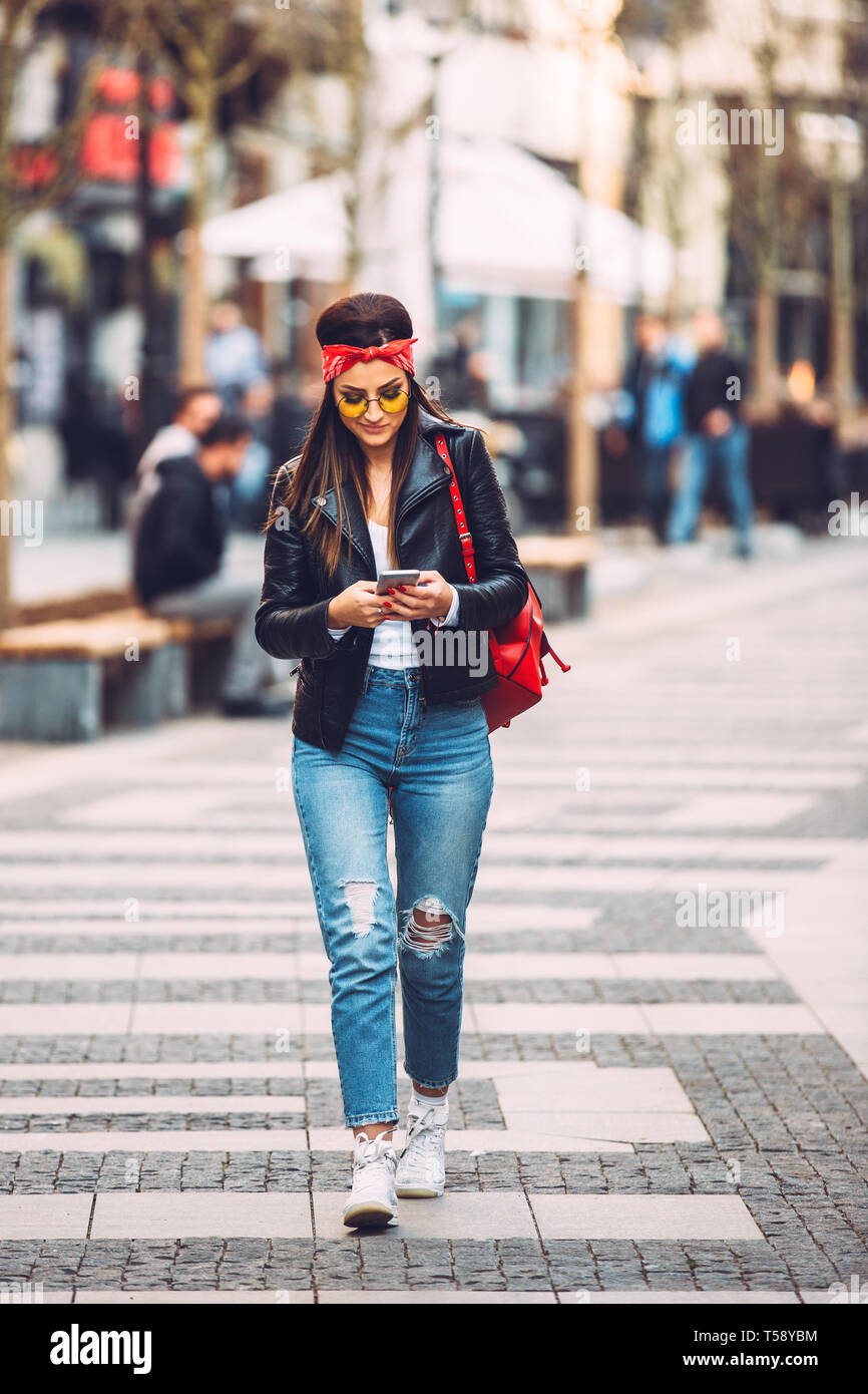 Portrait of young beautiful trendy girl in stylish sunglasses