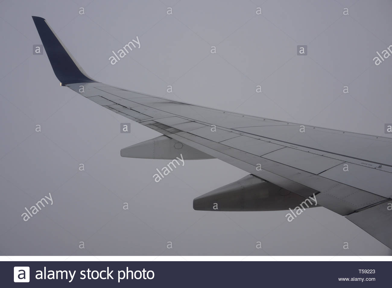 Delta airplane wing from airplane window. - Stock Image