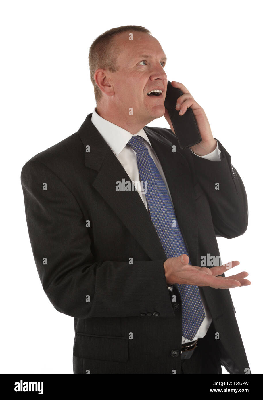 Exasperated male discussing on phone Stock Photo