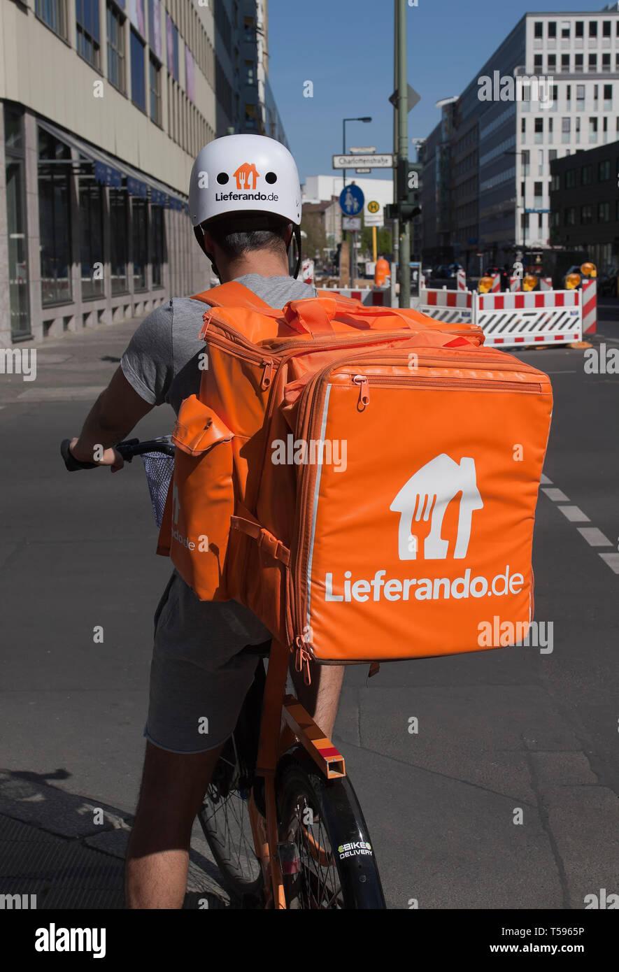 Bicyclist of delivery service Lieferando in Berlin Stock Photo