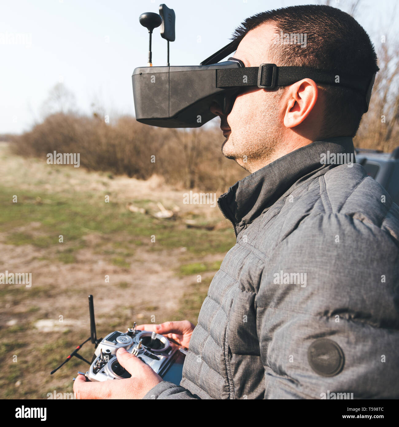 A man manages FPV drone in VR glasses Stock Photo: 244222956