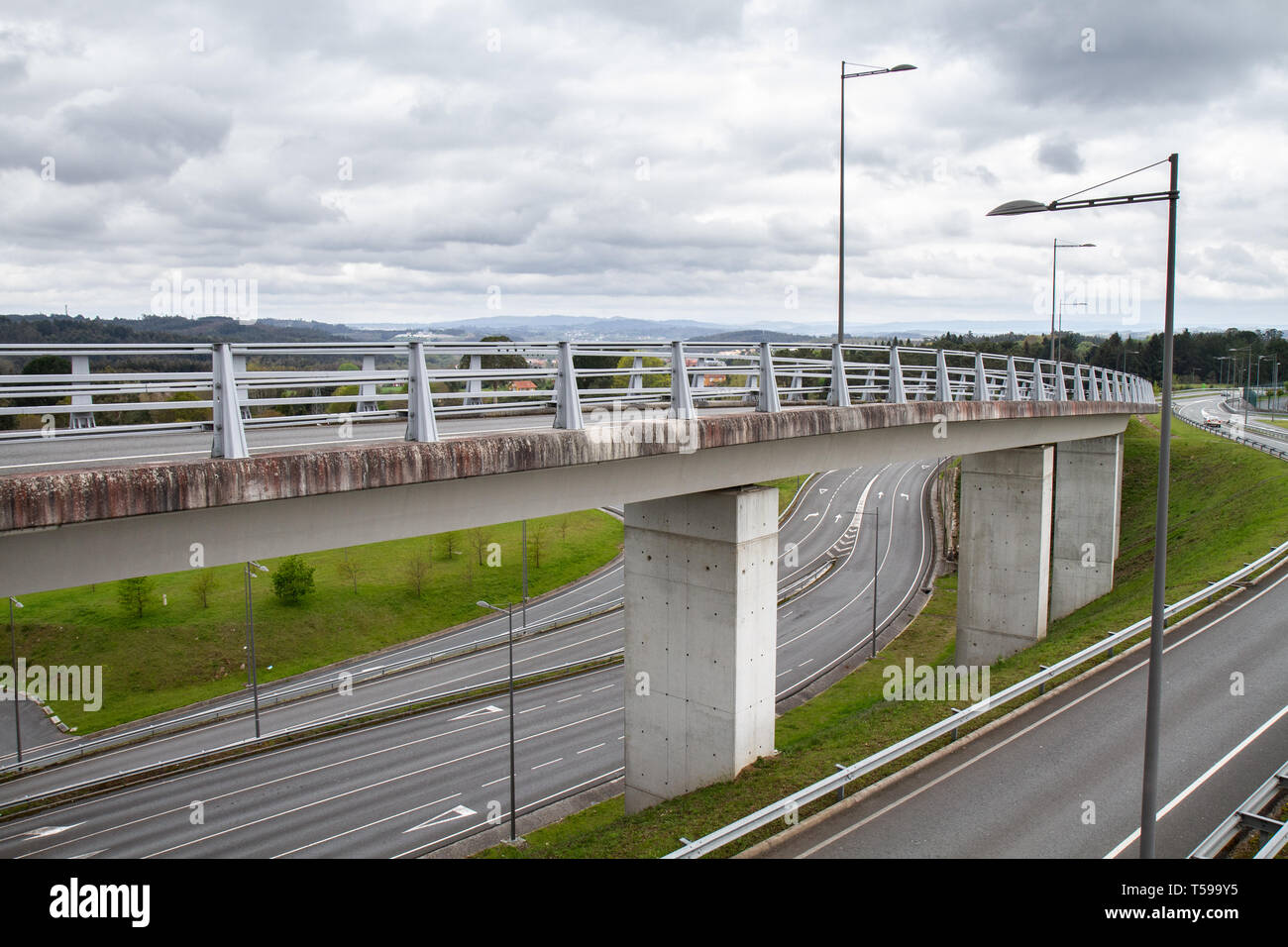 Many roads with connecting bridge. Infrastructure or road engineering concept - Stock Image