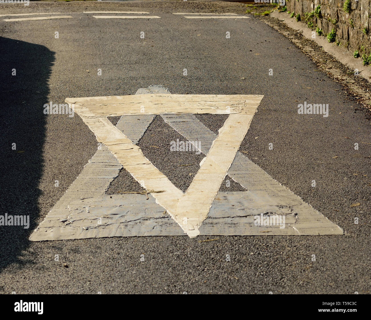 A confusing give-way sign. - Stock Image