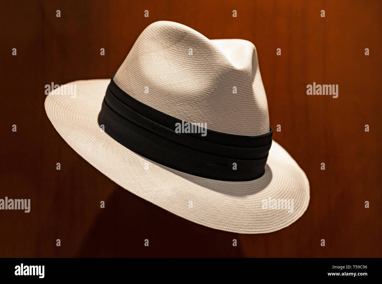 61cd429c A Panama hat or traditional brimmed straw hat made of the Toquilla palm, is  on