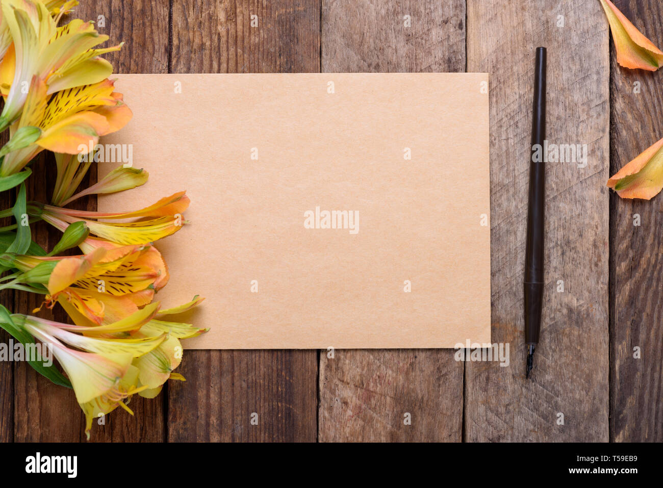 Blank Invitation Card With Flowers And Fountain Pen On Old