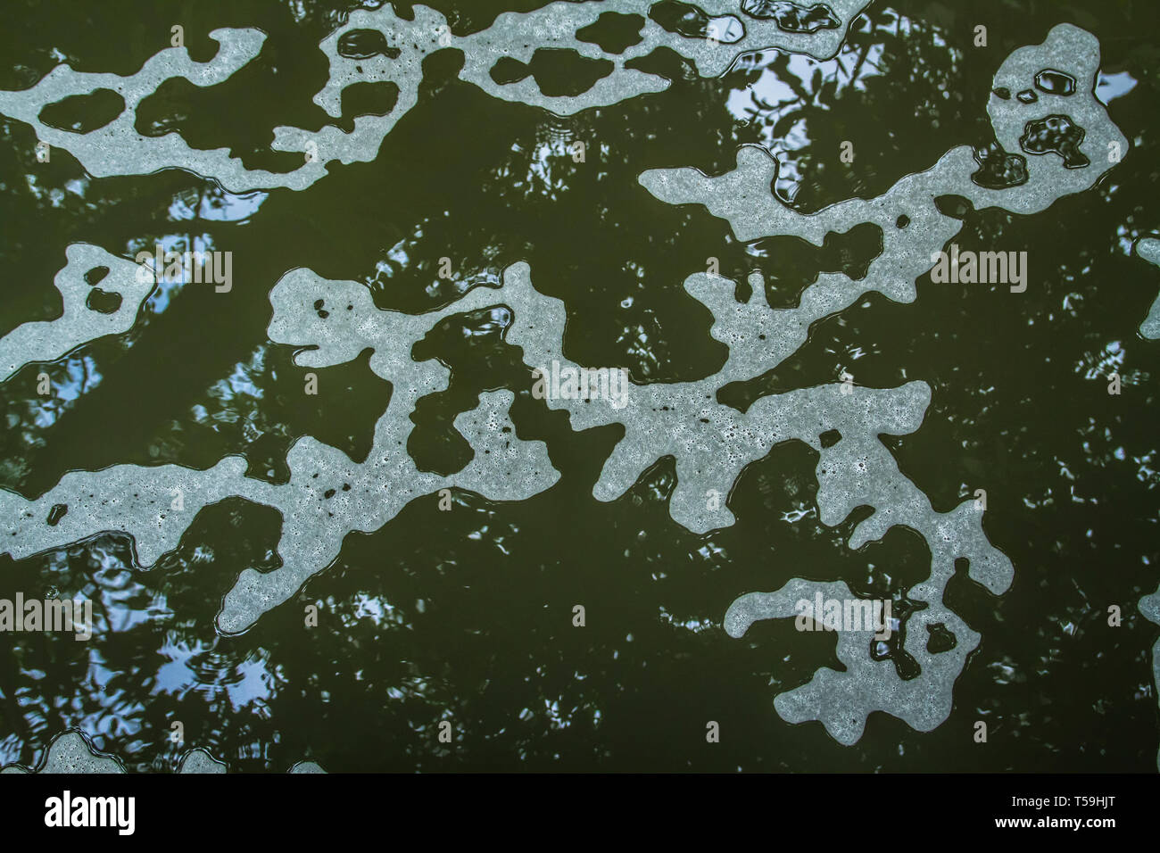 Foam patterns on the river water surface - Stock Image