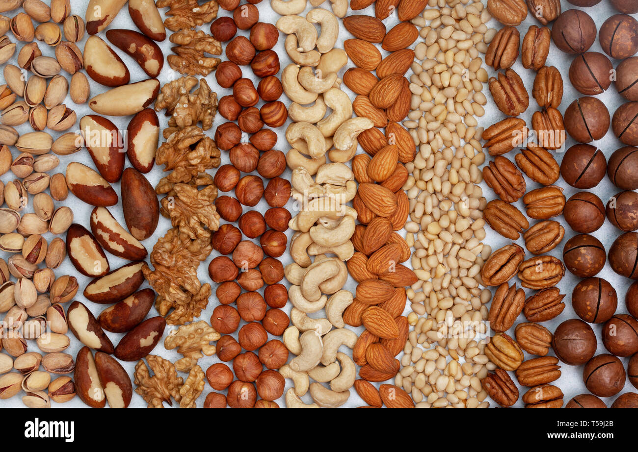 background from a mixture of nuts on a light background. view from above Stock Photo