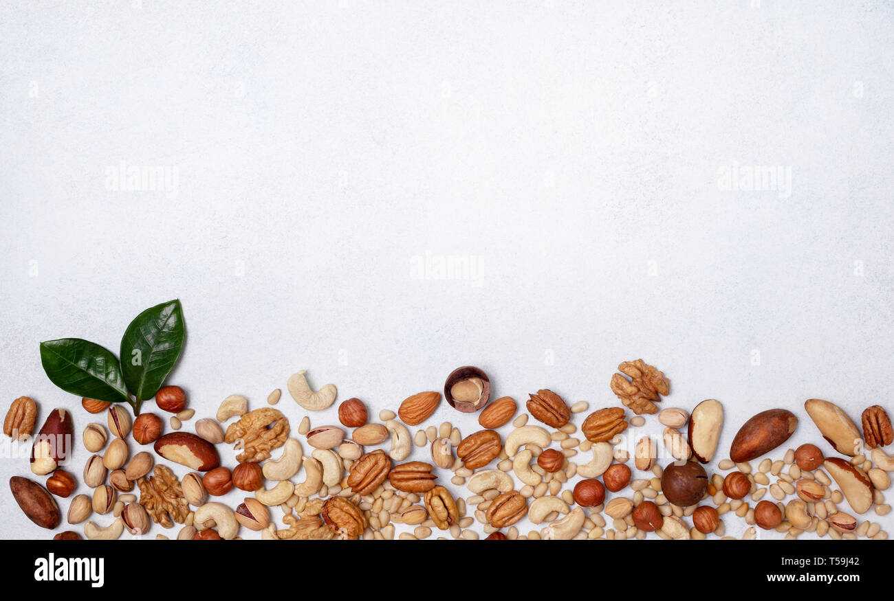 mix of nuts on a light background. view from above. banner. copy space Stock Photo