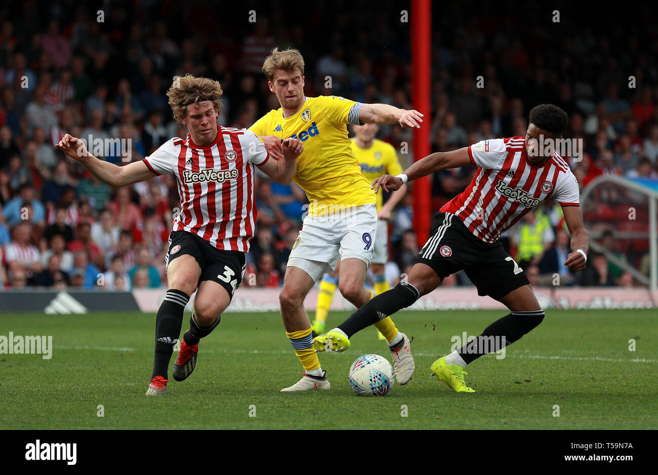 f67d848f Leeds United's Patrick Bamford battles for the ball with Brentford's Mads  Bech Sorensen (left) and Julian Jeanvier (right) during the Sky Bet  Championship ...