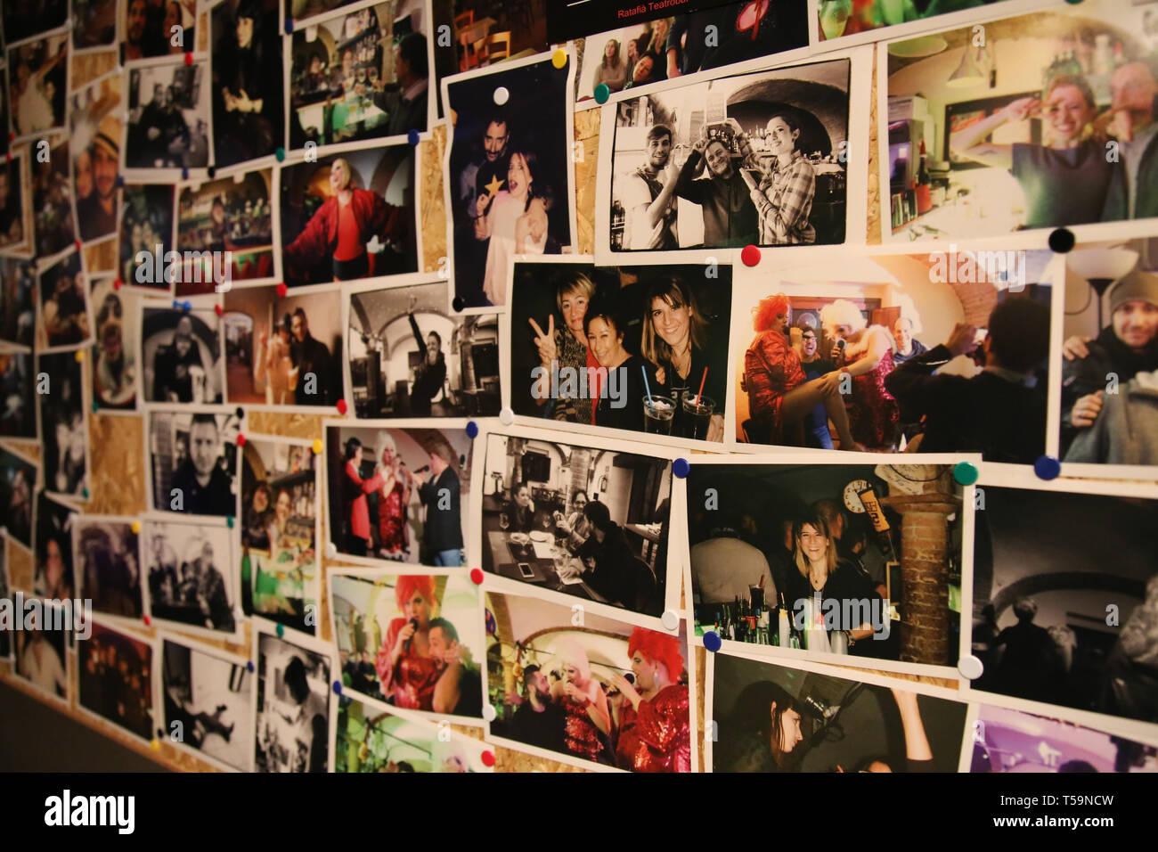 Photographs of various people on the wall - Stock Image
