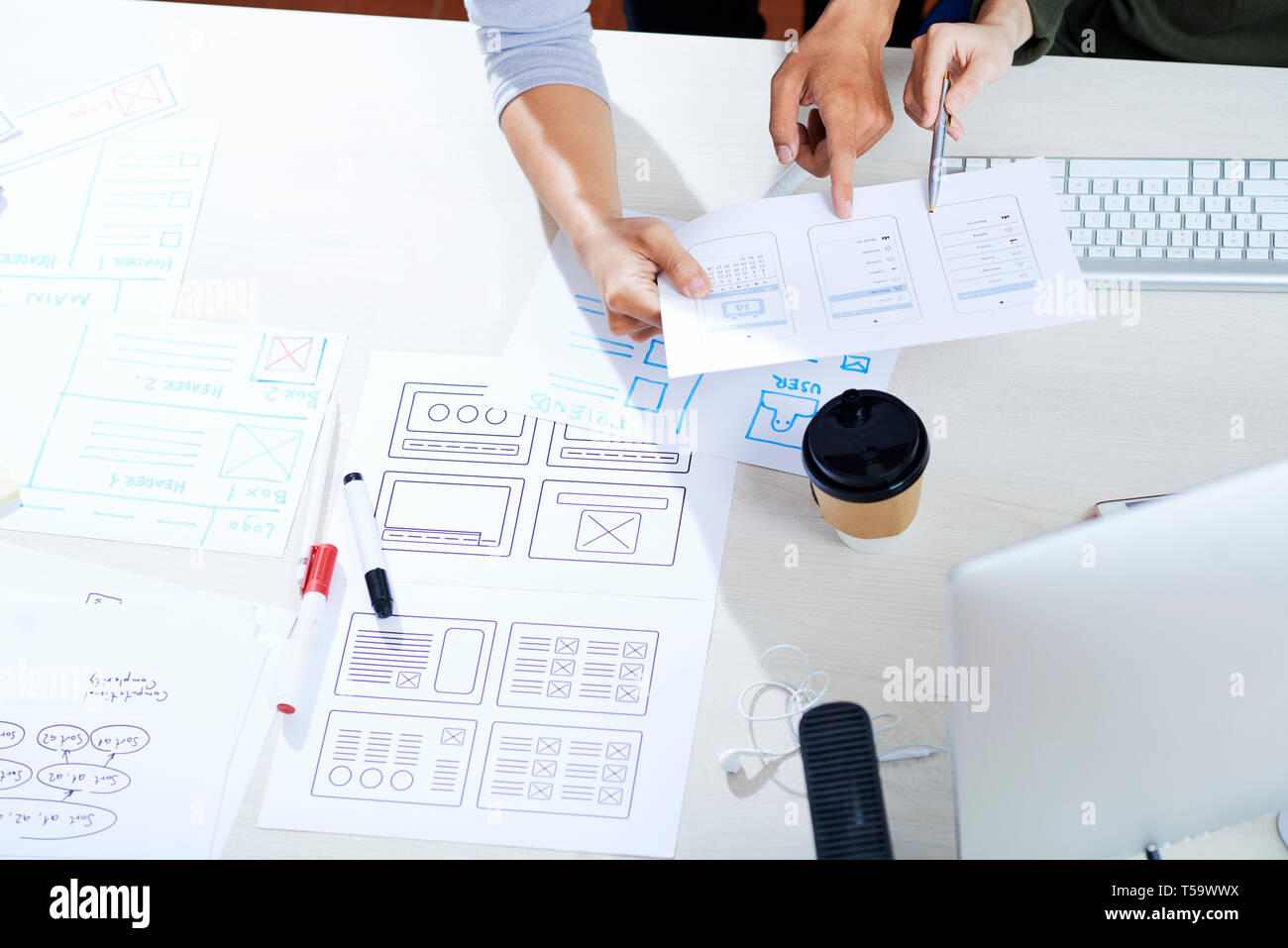 Discussing ux design for mobile app - Stock Image
