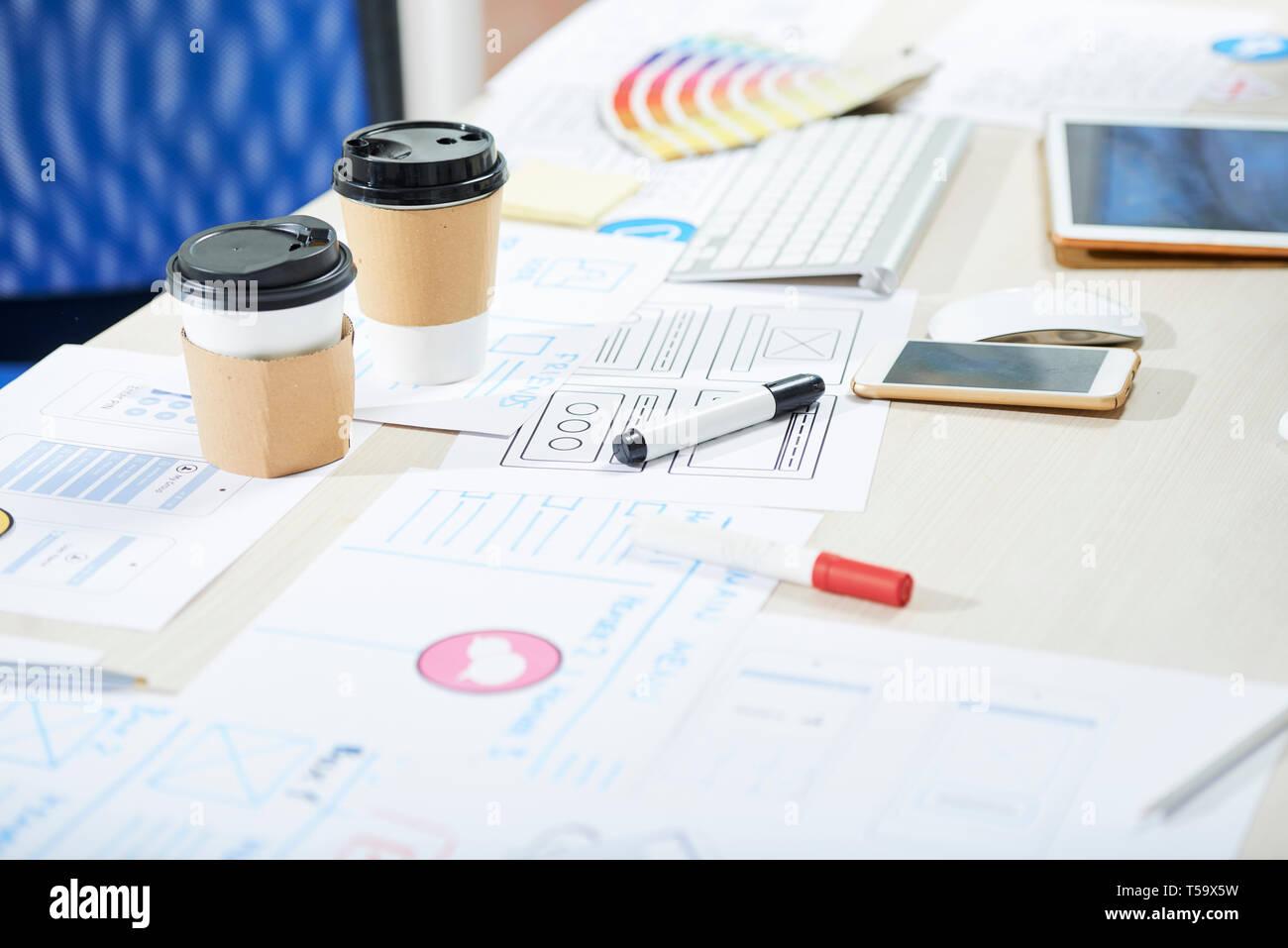 Mess on desk of ux designer - Stock Image