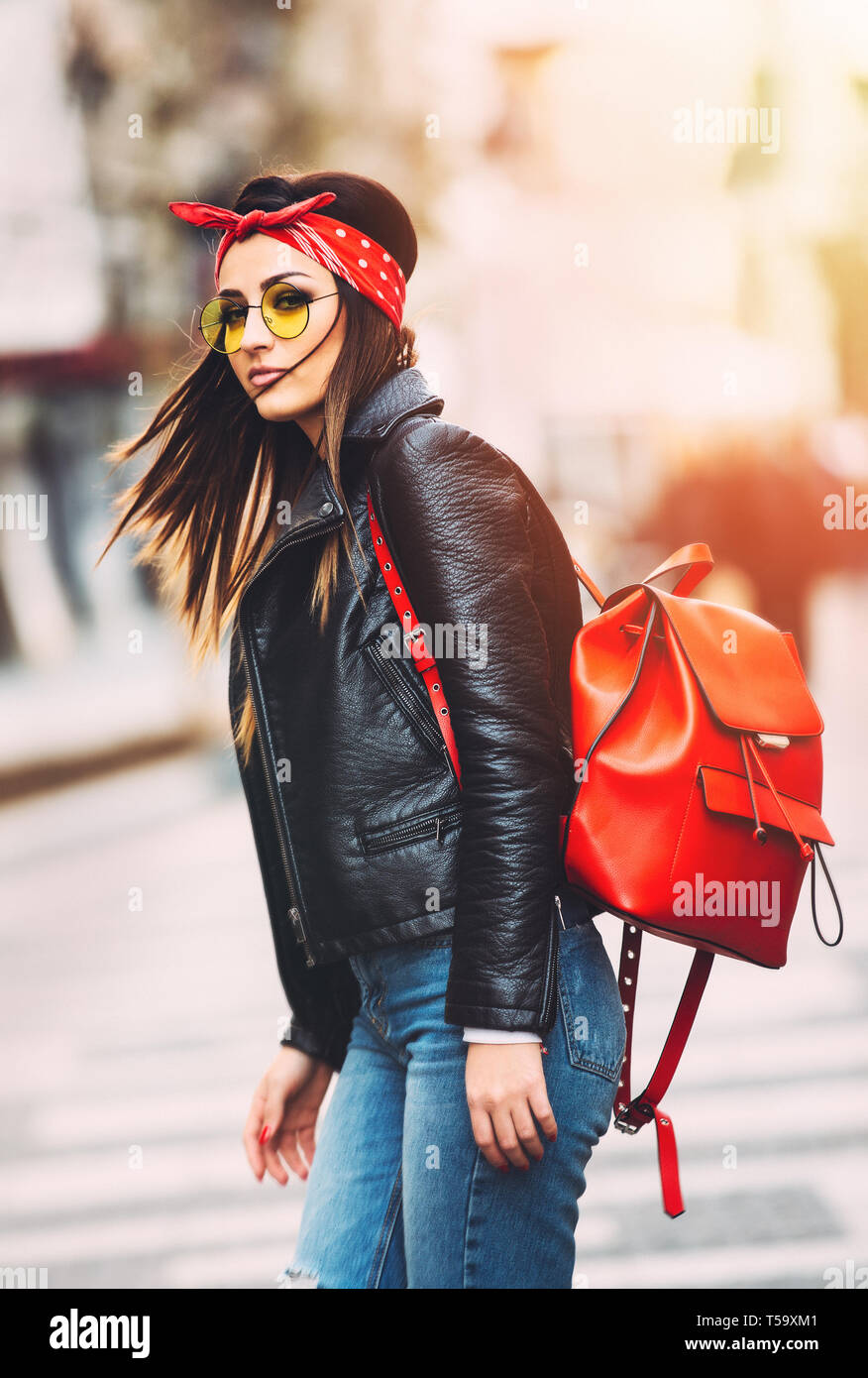Portrait of young beautiful trendy girl in stylish sunglasses ad