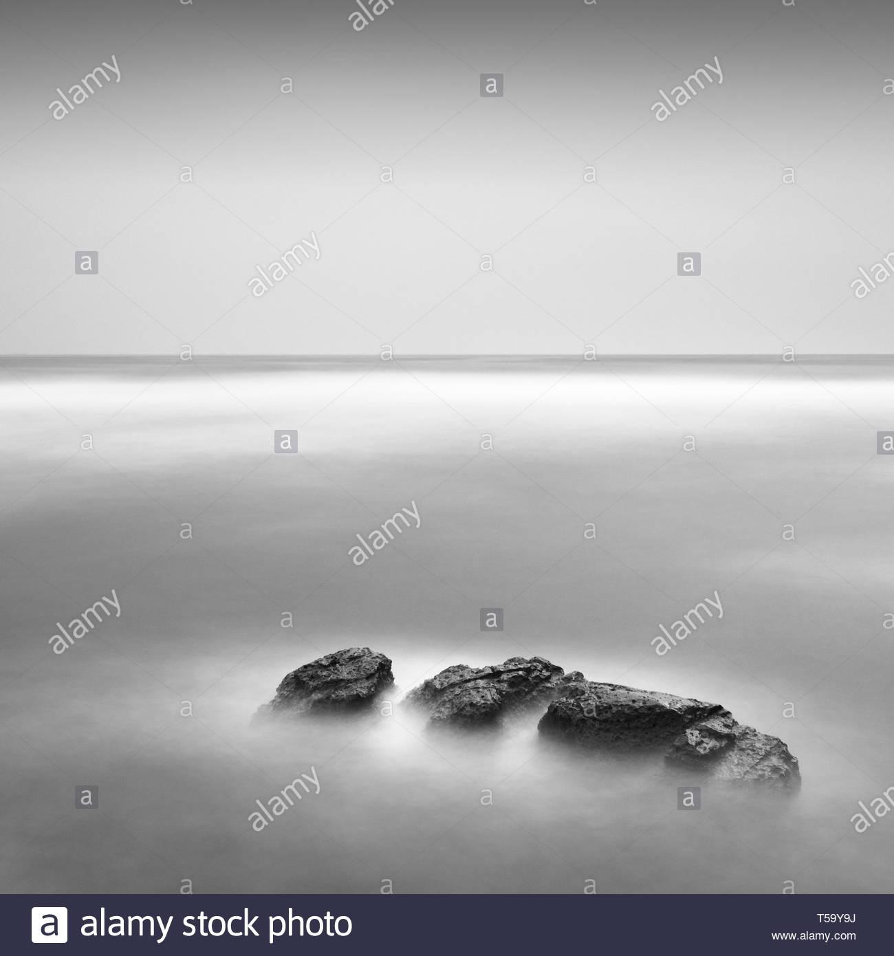Long exposure of sea rocks in Inamuragasaki, Kanagawa Prefecture - Stock Image