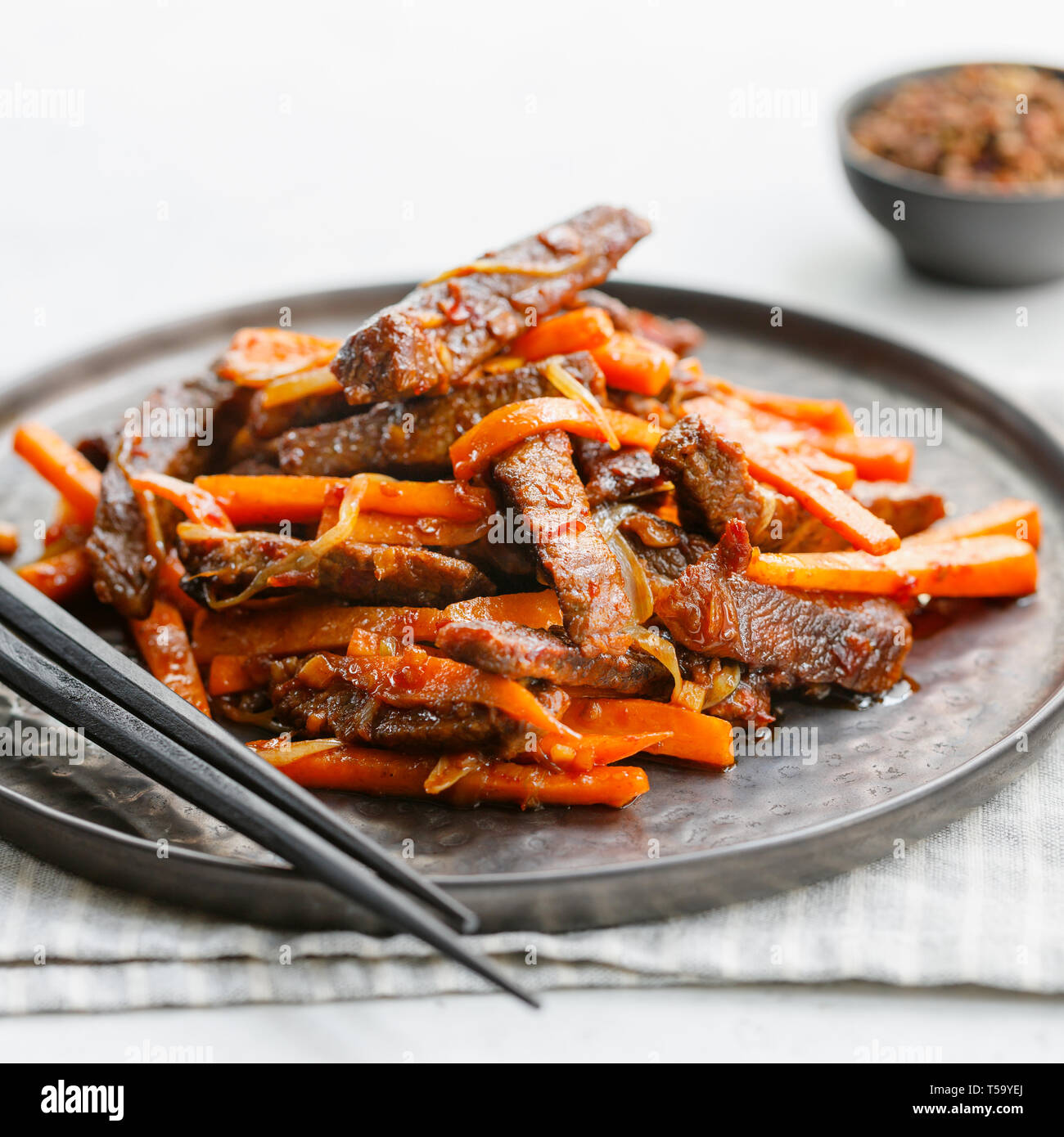Close-up of Chinese spicy Szechuan beef meal on a black