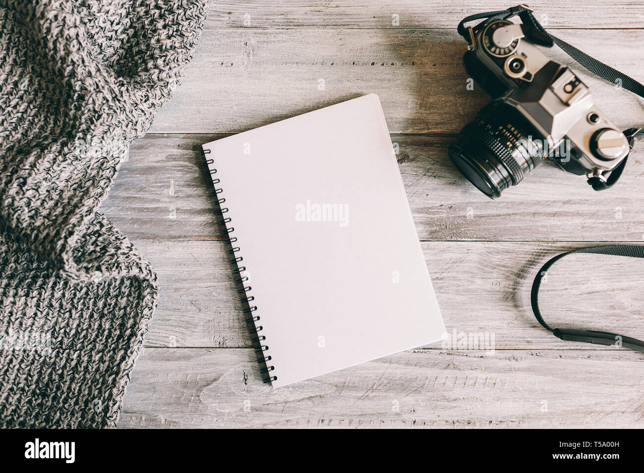 Accessories of traveler on wooden table in flat lay design. Travel concept. - Stock Image