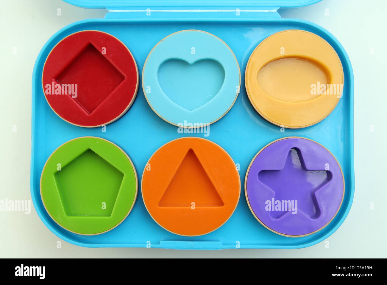 Kids shape learning toy. Various shapes. Guessing shape game. - Stock Image