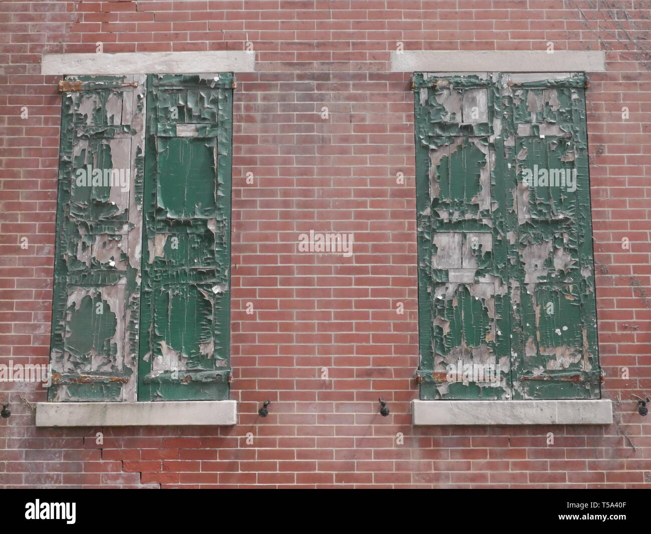 Urban Rustic Charm. Old shutters. Vintage. Downtown - Stock Image