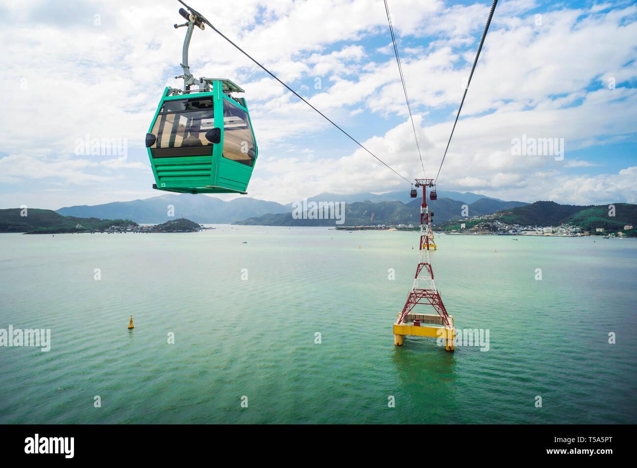 The view towards Nha Trang and VinPearl cable car from Nha Trang bay in Vietnam. - Stock Image