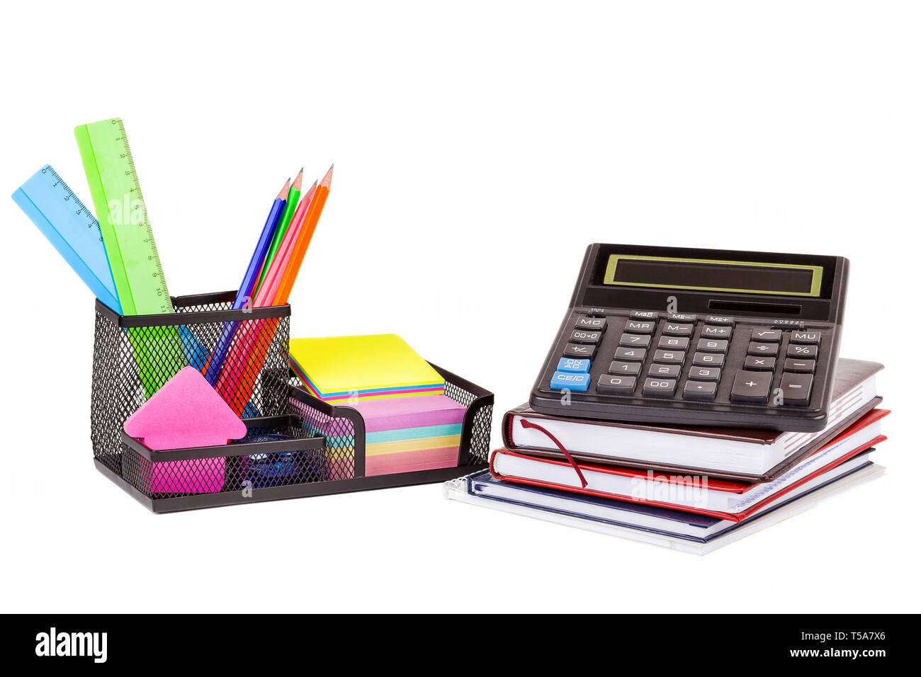 Stationery isolated on white. Notebooks, markers, pencils, rulers, stickers, stapler, calculator - Stock Image
