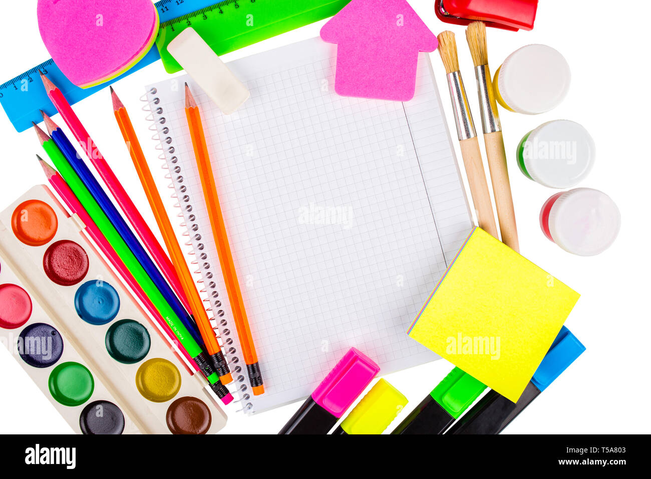 Stationery isolated on white. Notebooks, markers, pencils, rulers, stickers, stapler, paints - Stock Image