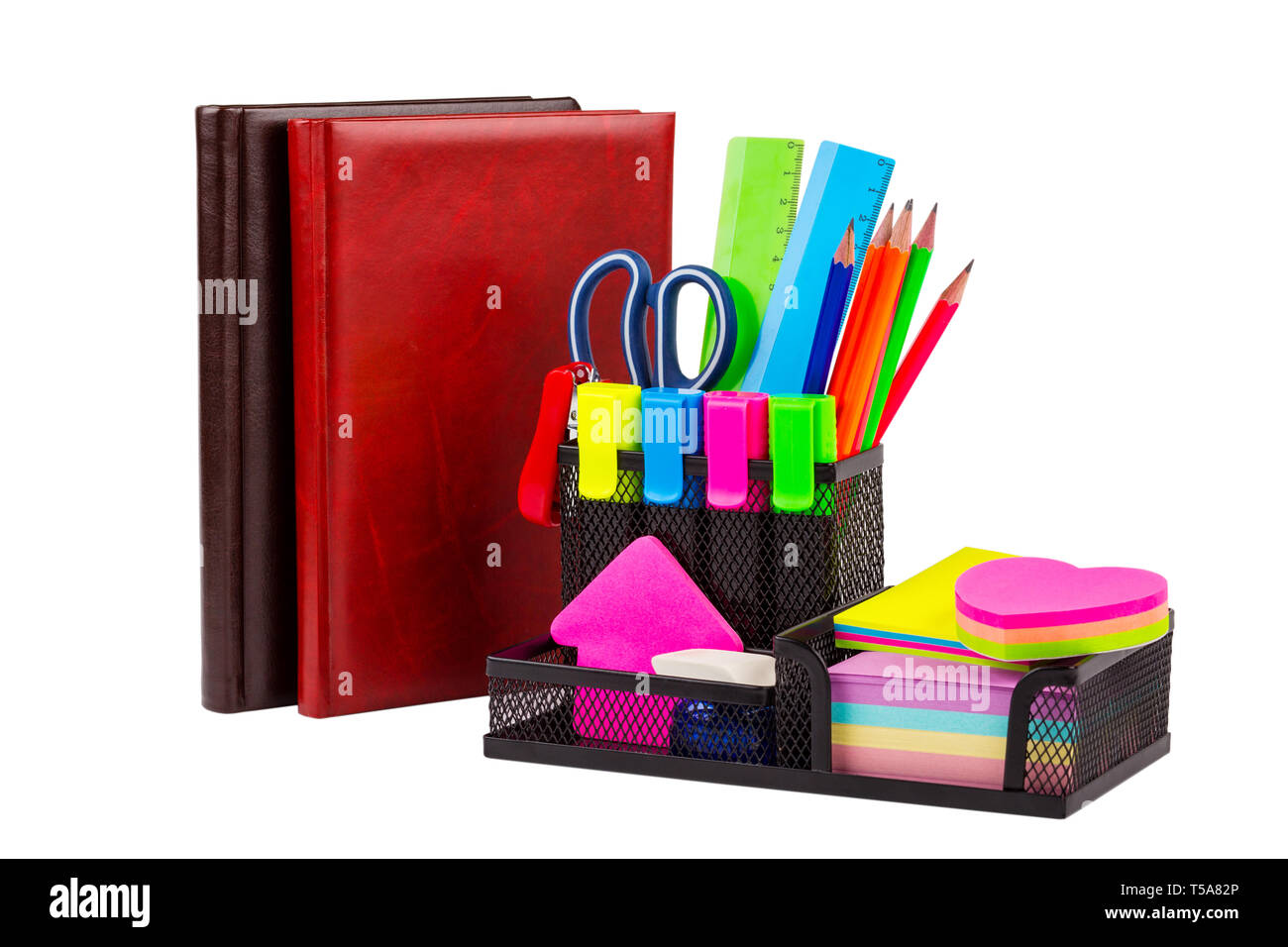 Stationery isolated on white. Notebooks, scissors, markers, pencils, rulers, stickers, stapler - Stock Image
