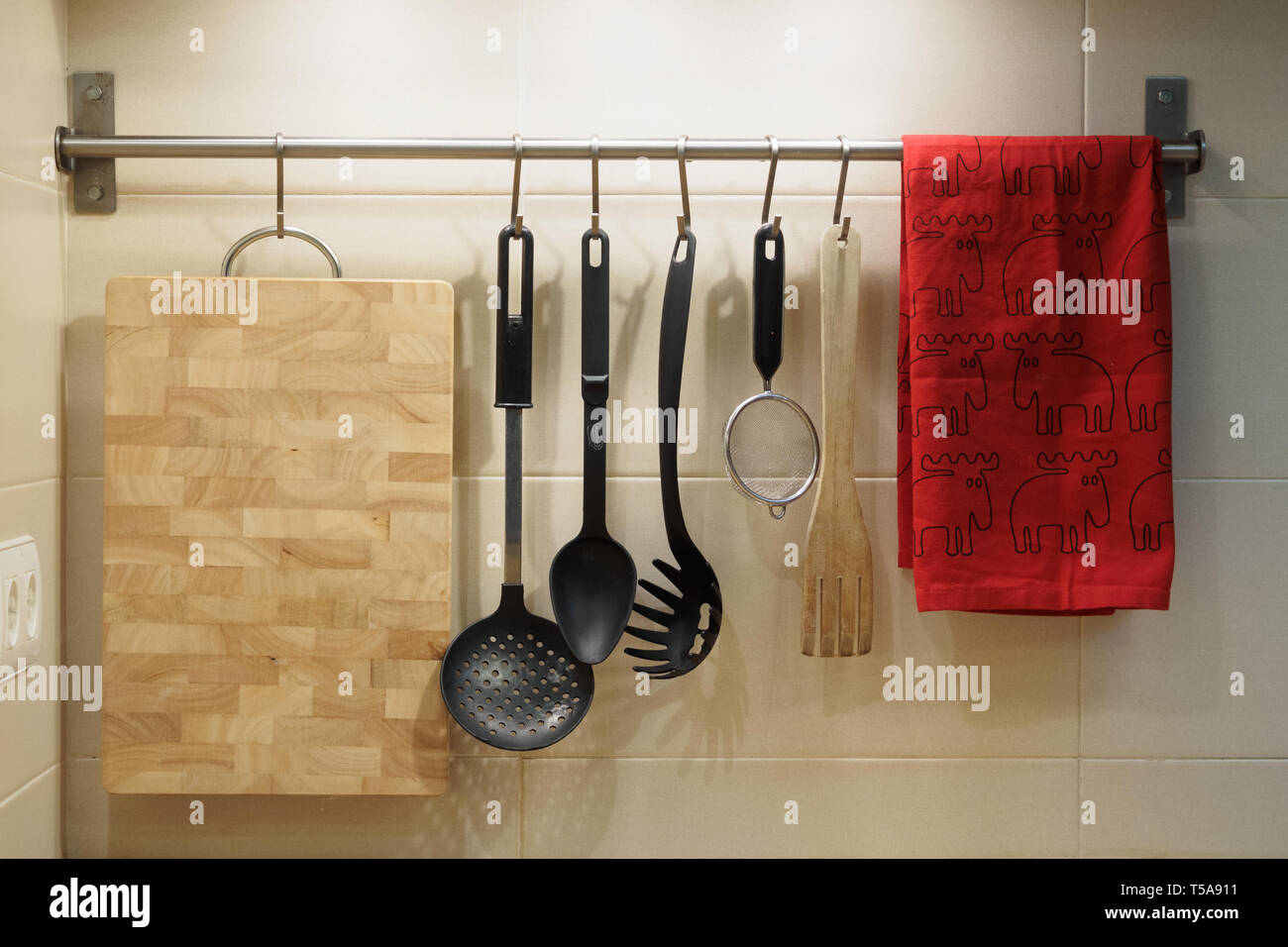 Kitchen Utensils Hanging On The Wall Stock Photo Alamy