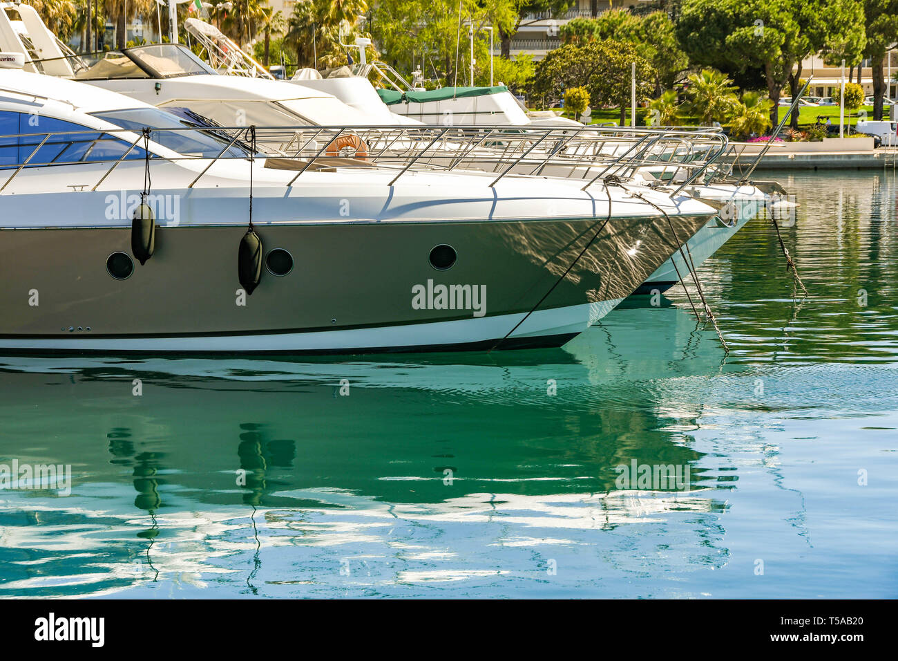 CANNES, FRANCE - APRIL 2019: Luxury motor cruisers in the Port Pierre Canto marina in Cannes. Stock Photo