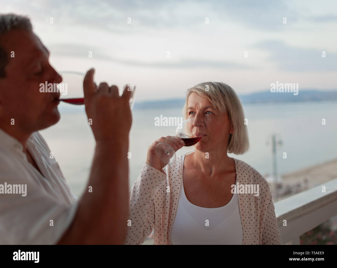 One more sip before sunset - Stock Image