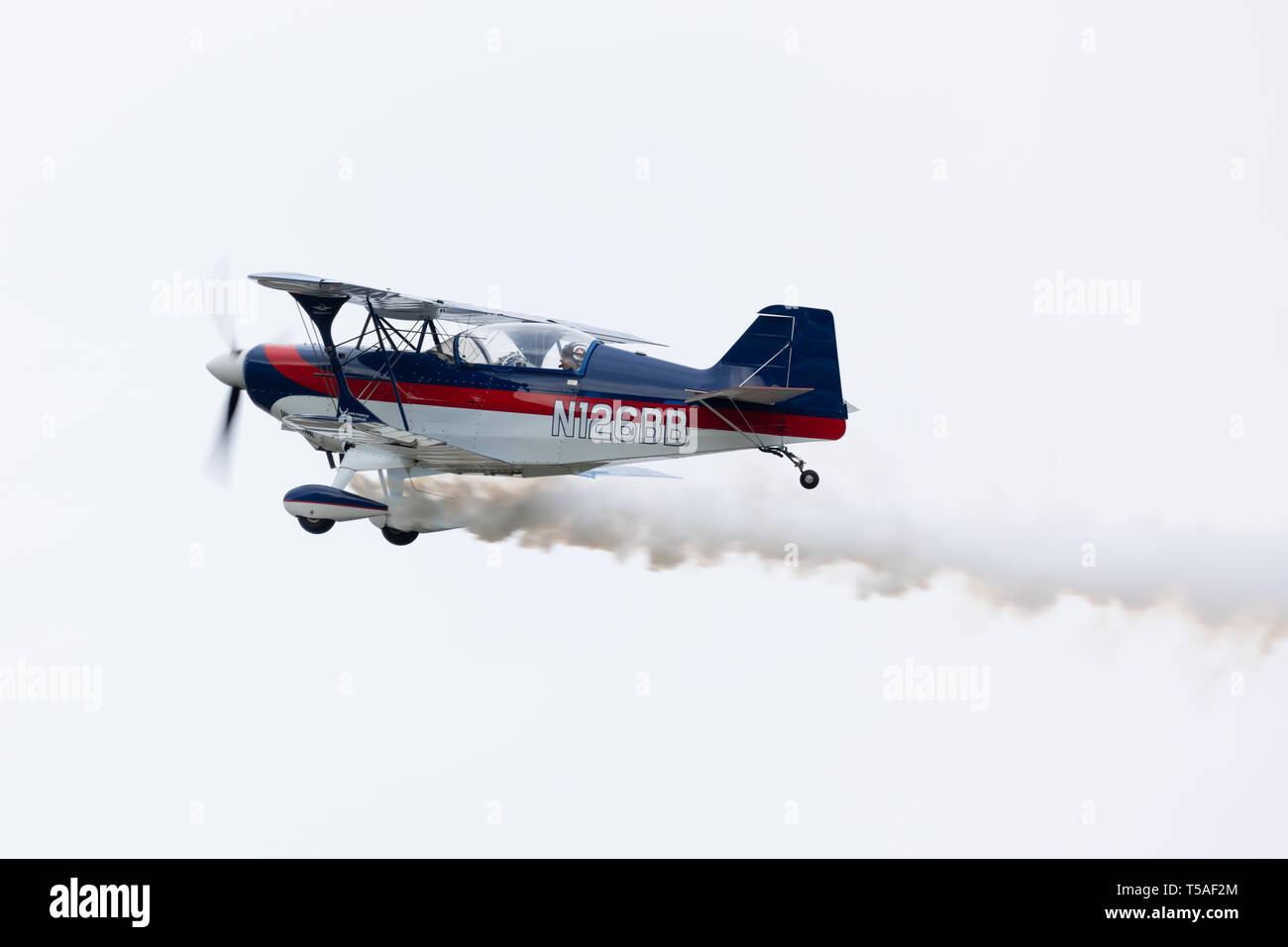 Louisville, Kentucky, USA - April 13, 2019: Thunder Over Louisville, Pitts S2C trailing smoke flying by over the Ohio River - Stock Image