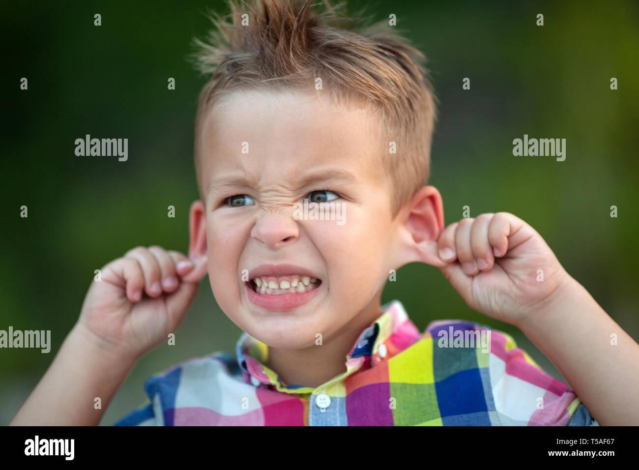 A grimacing kid - Stock Image