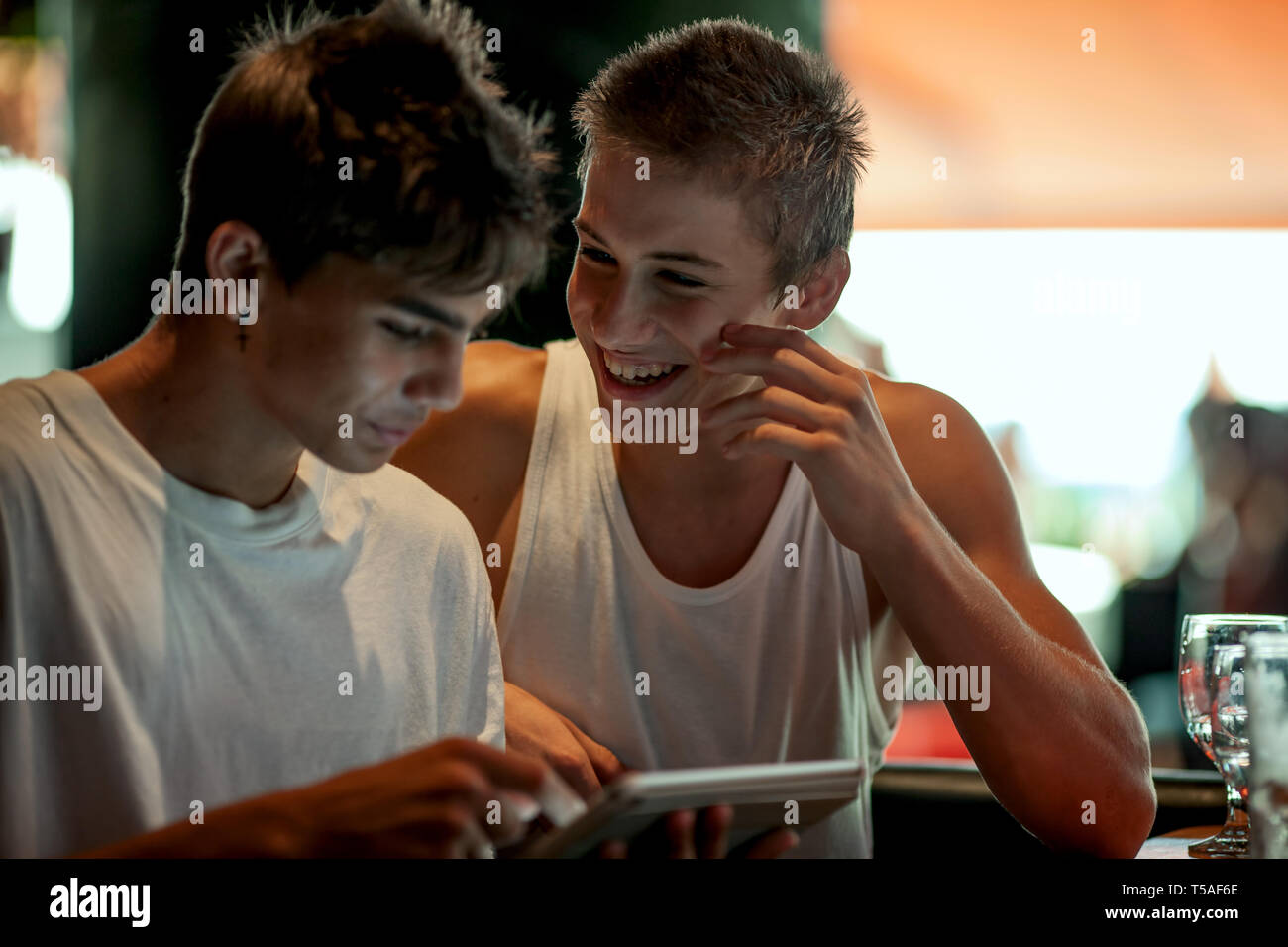 Young boys in a cafe - Stock Image